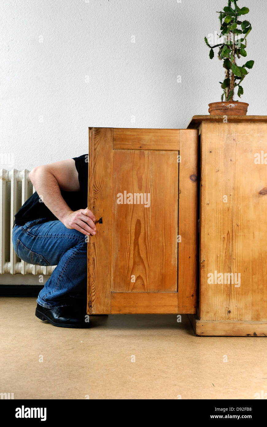 Man Is Looking Inside A Cabinet Stock Photo Alamy