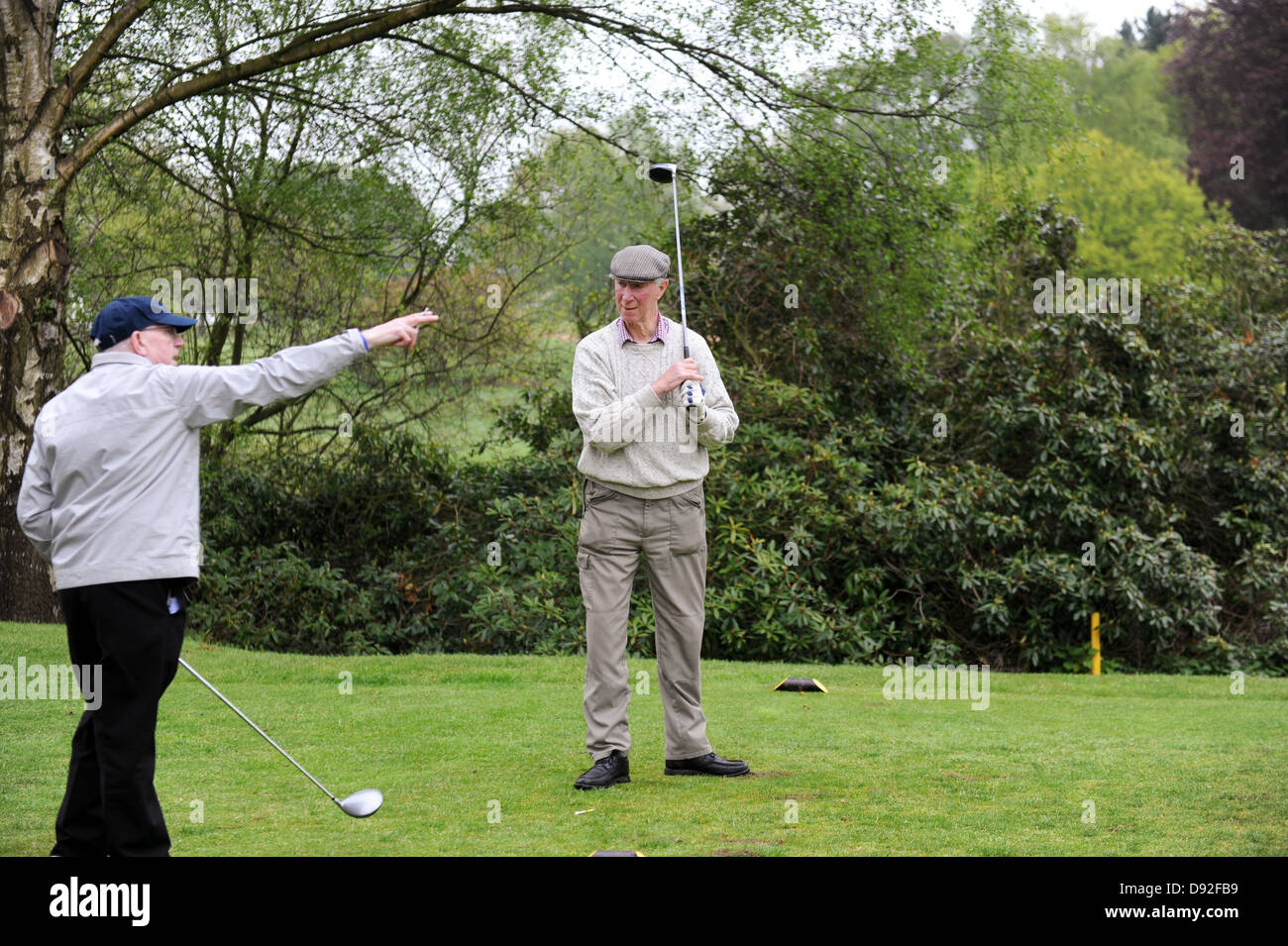 England 1966 world cup winning footballer Jack Charlton gets a golf trip from Nobby Stiles at Brocton Hall Golf - Stock Image