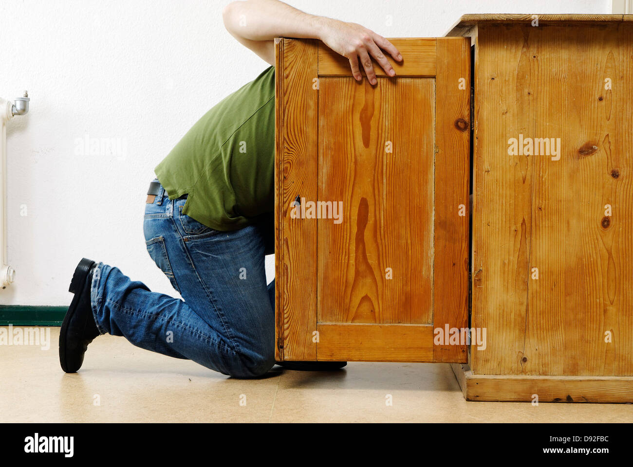 Man Is Looking Inside A Cabinet Stock Photo 57218992 Alamy