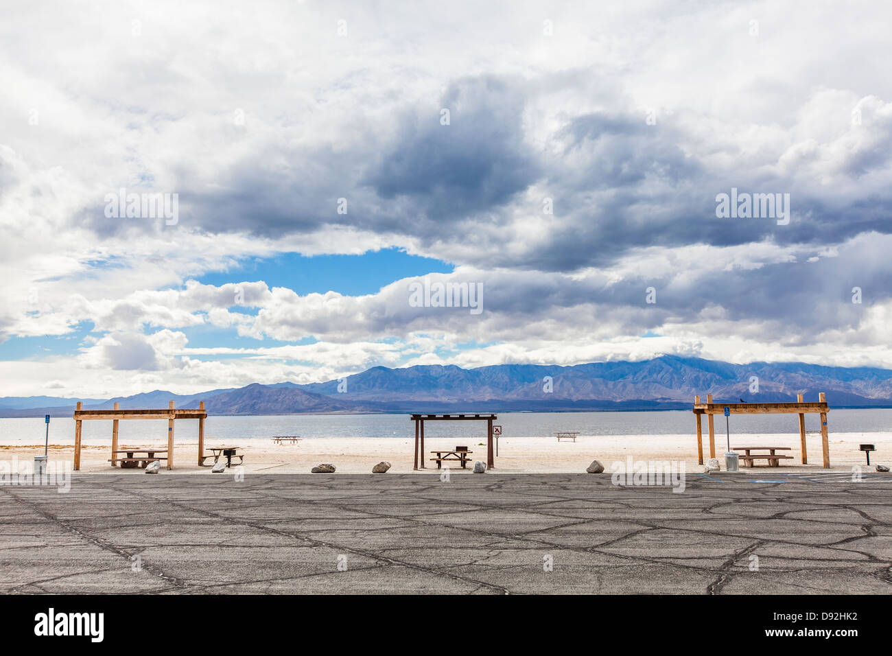 Picnic areas with overhead shelter from the sun and picnic benches at the Salton Sea Recreational Area located in - Stock Image