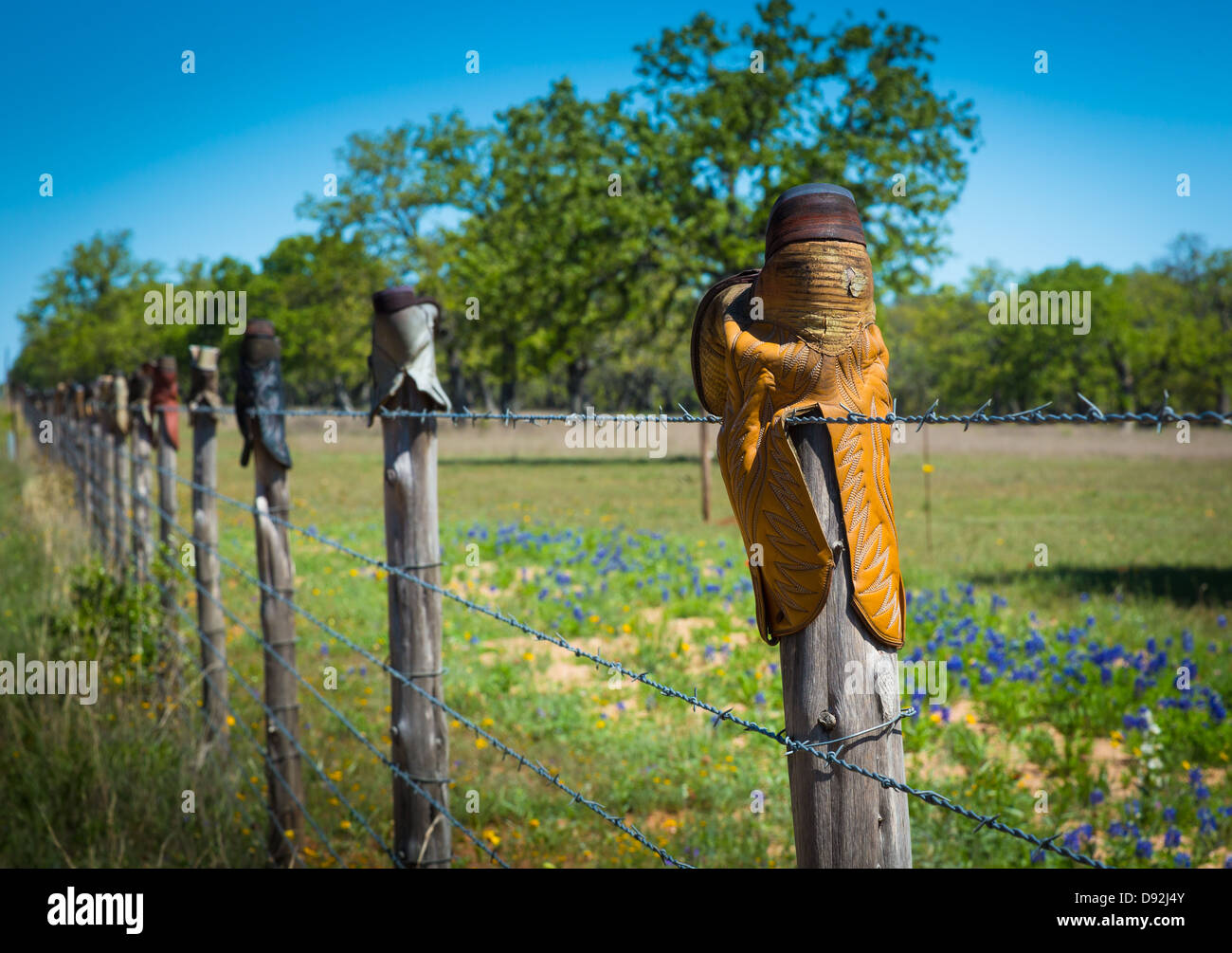 19ef0e837cad Fence posts topped with cowboy boots in the Texas Hill Country Stock ...