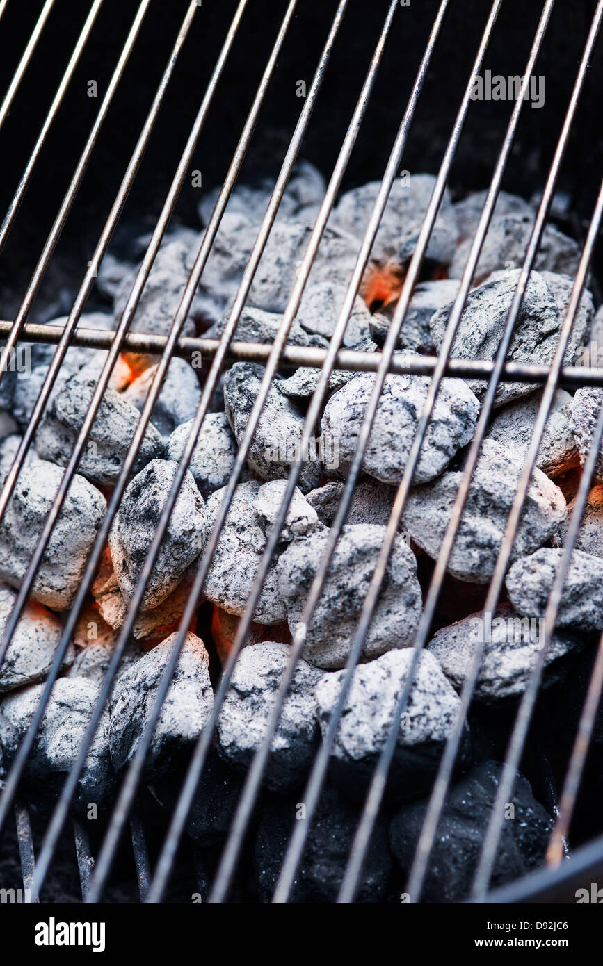 Glowing charcoals on the grill - Stock Image