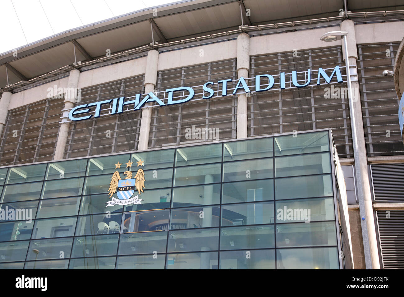 Etihad (formerly the City of Manchester) Stadium, home of Manchester City FC with old crest displayed - Stock Image