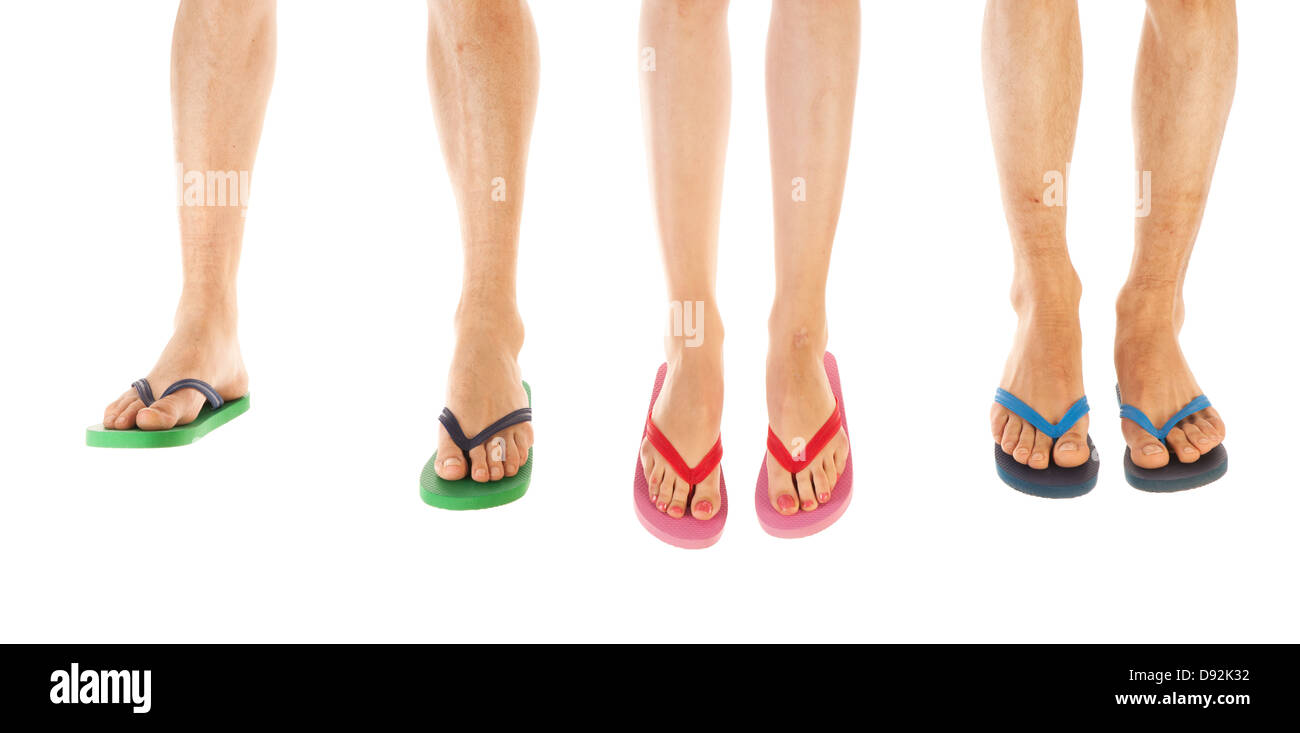 Many feet in colorful summer flip flops - Stock Image