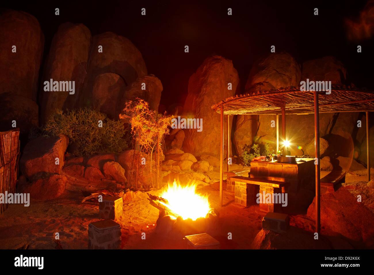 Campfire among the rocks, Ranch Koiimasis camp site, Tiras Mountains, Southern Namibia, Africa - Stock Image
