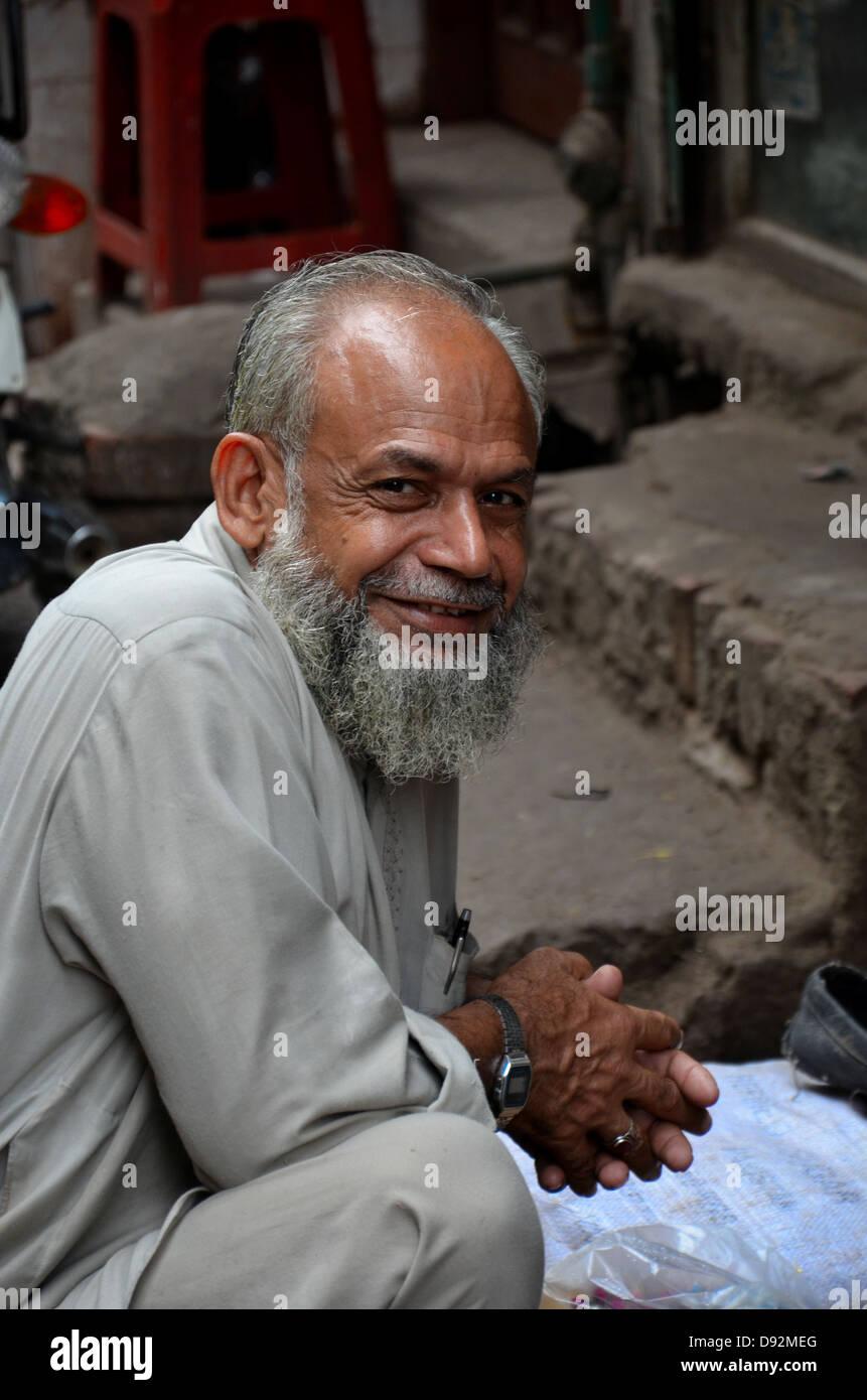 Man smiles for camera: Lahore, Pakistan - Stock Image