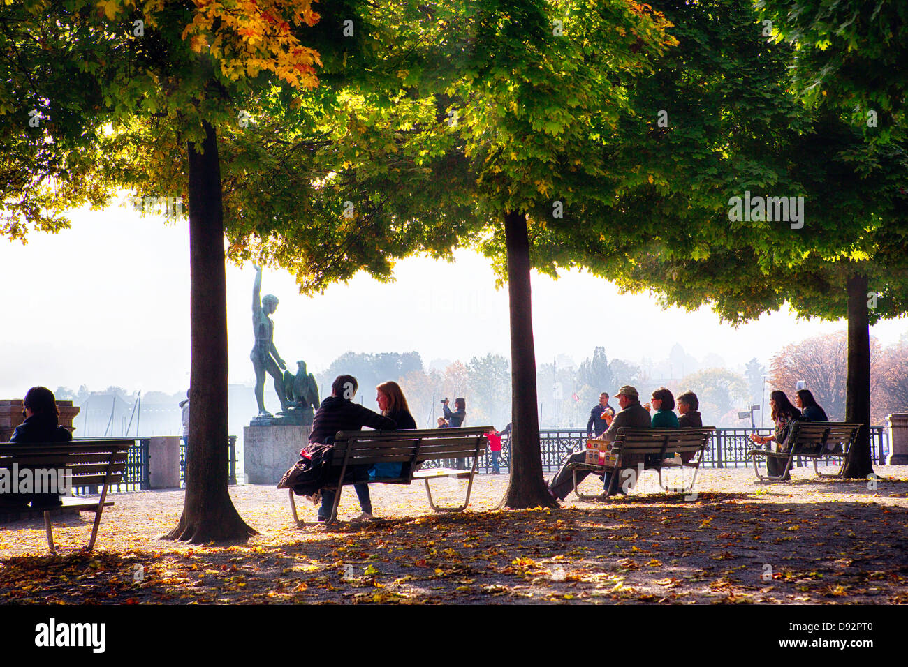 People Relaxing in a Park, Bürkliplatz, Zurich, Canton of Zurich, Switzerland - Stock Image