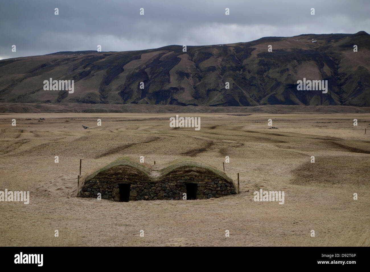 Bunkers in the middle of a mowed field - Stock Image