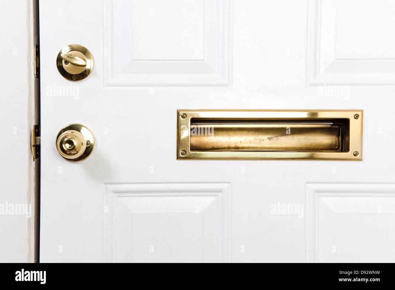 A Front Door With Mail Slot Doorknob And Deadbolt Lock Stock Photo