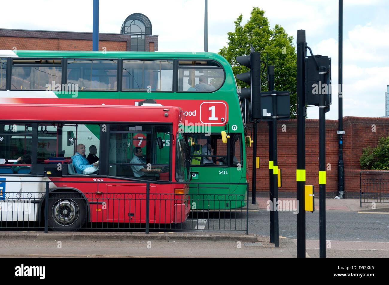 Buses stopped at traffic lights, Wolverhampton, West Midlands, England, UK - Stock Image