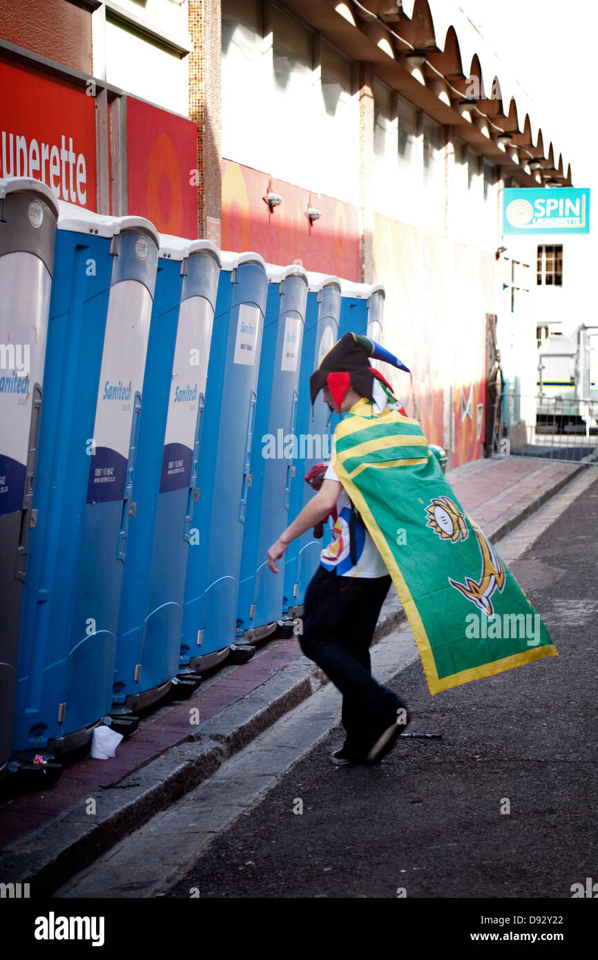 bc384e740d1 South African soccer fan wearing Springbok flag novelty hat walks into  public toilet on Long Street during FIFA world cup final