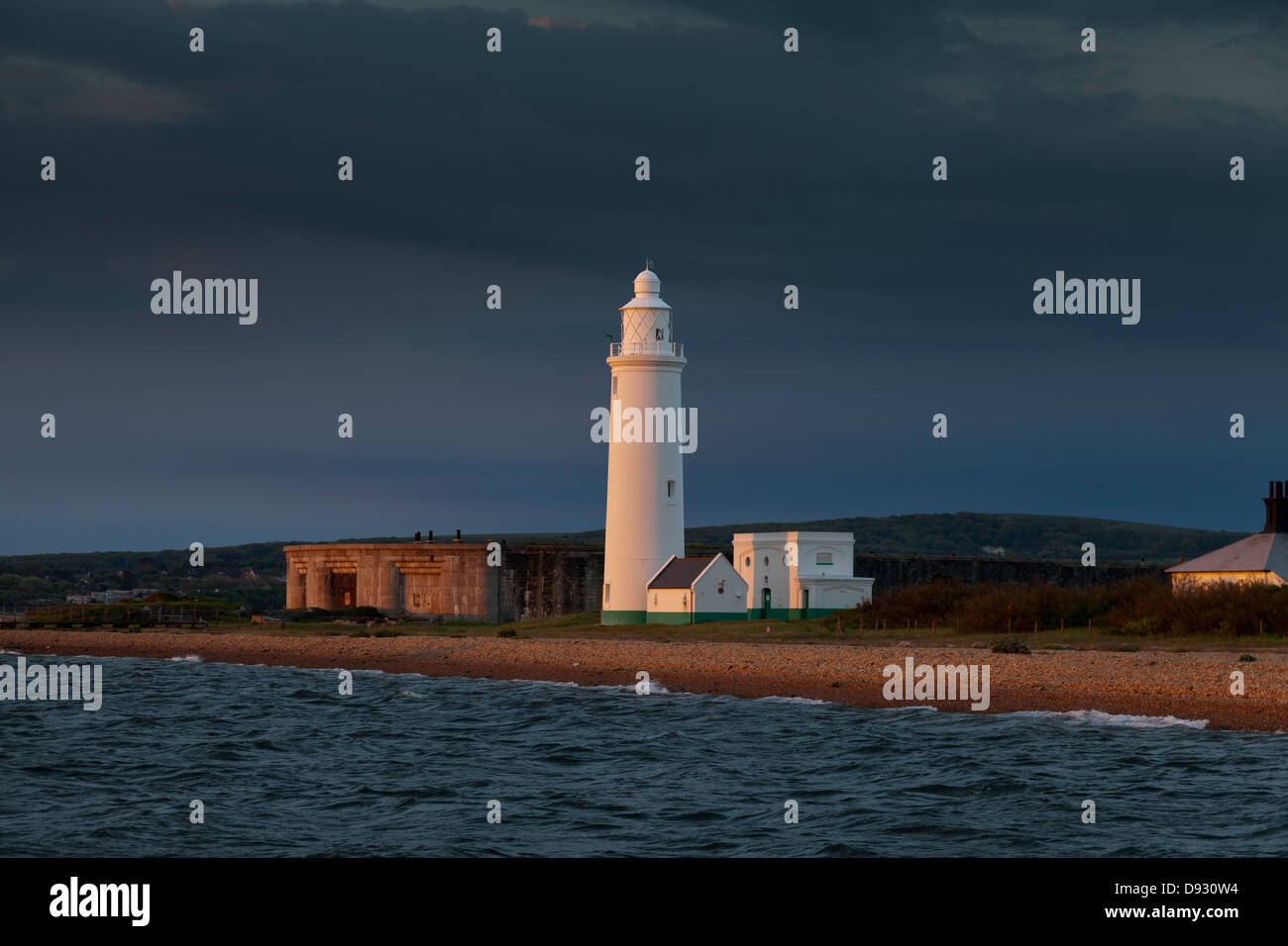 Hurst lighthouse castle maritime fortifications at sun rise shingle spit Keyhaven Solent defense warning safety - Stock Image