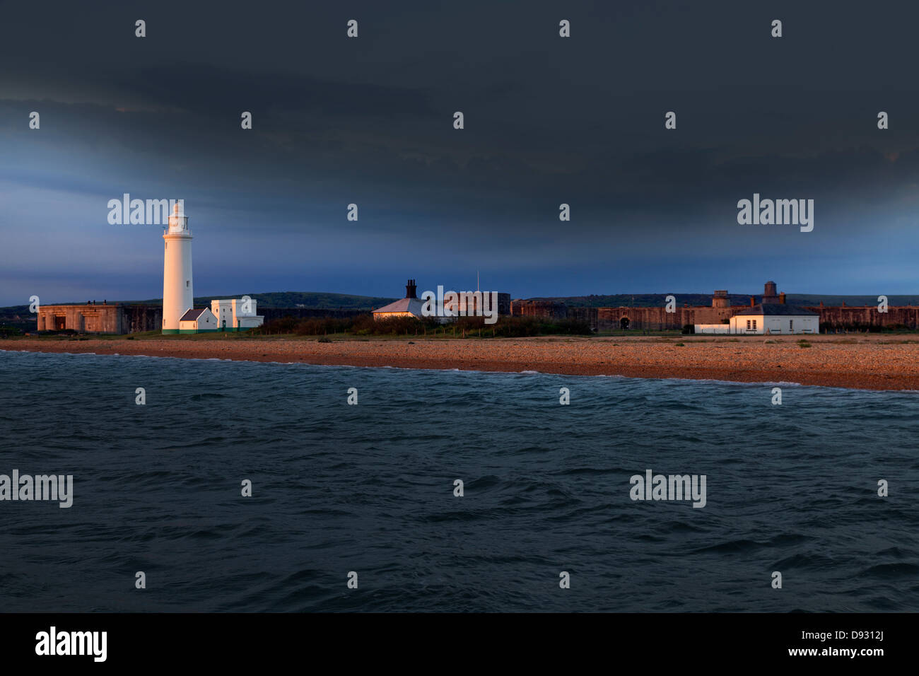 Hurst lighthouse and castle maritime fortifications at sun rise - Stock Image