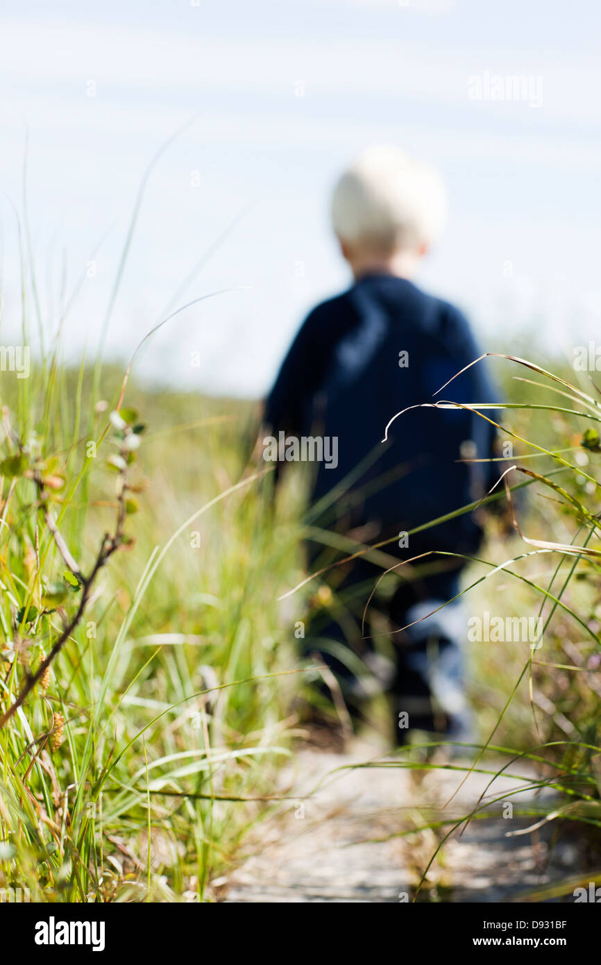 Grass, boy in background - Stock Image