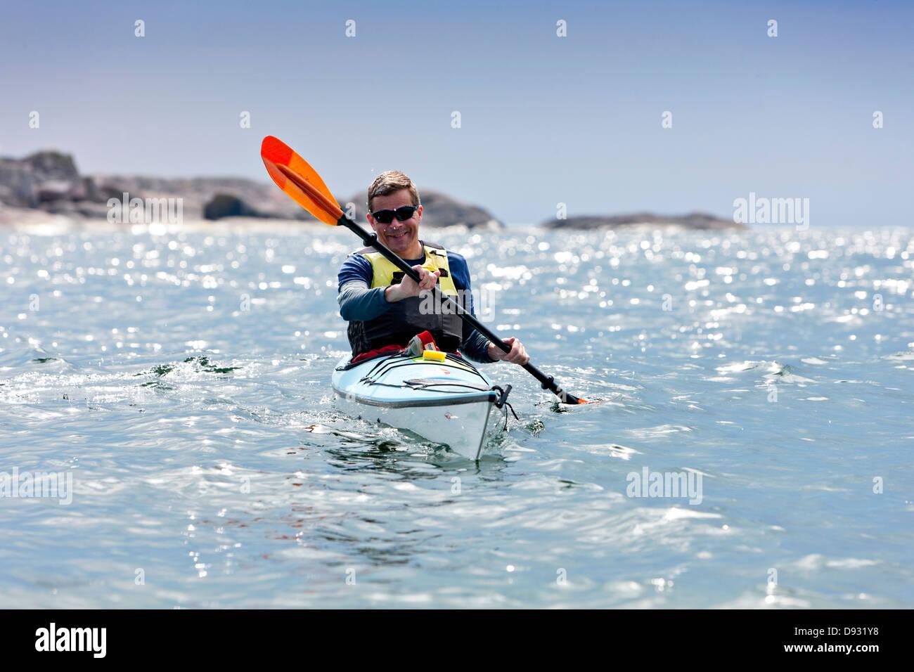 Man paddling - Stock Image