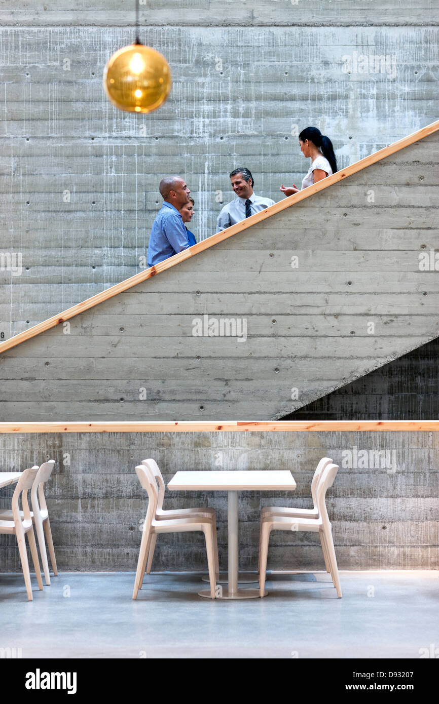 Men and women talking on stairs - Stock Image