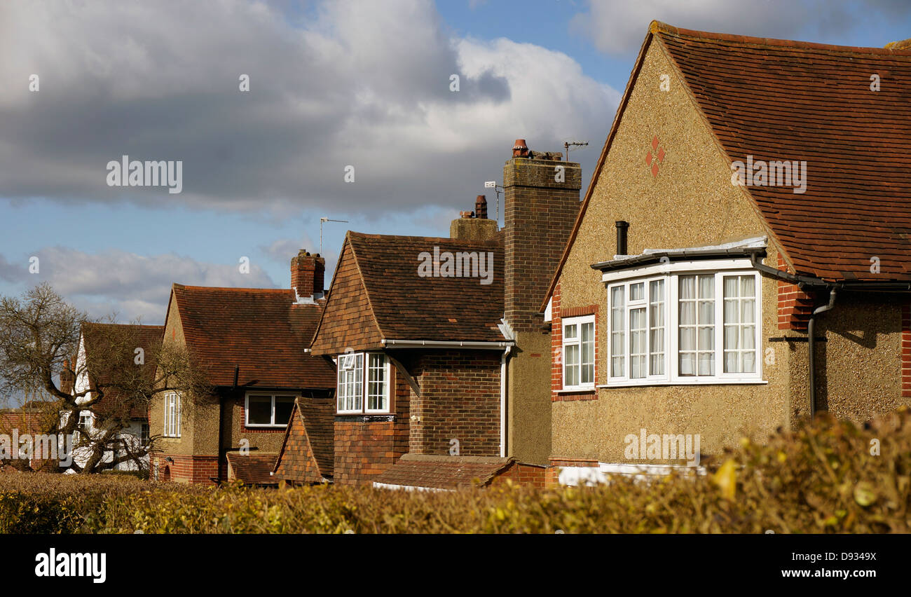 A row of detached 1930s bay window period houses, in the afternoon sunlight, Banstead, Surrey, near London, England, - Stock Image