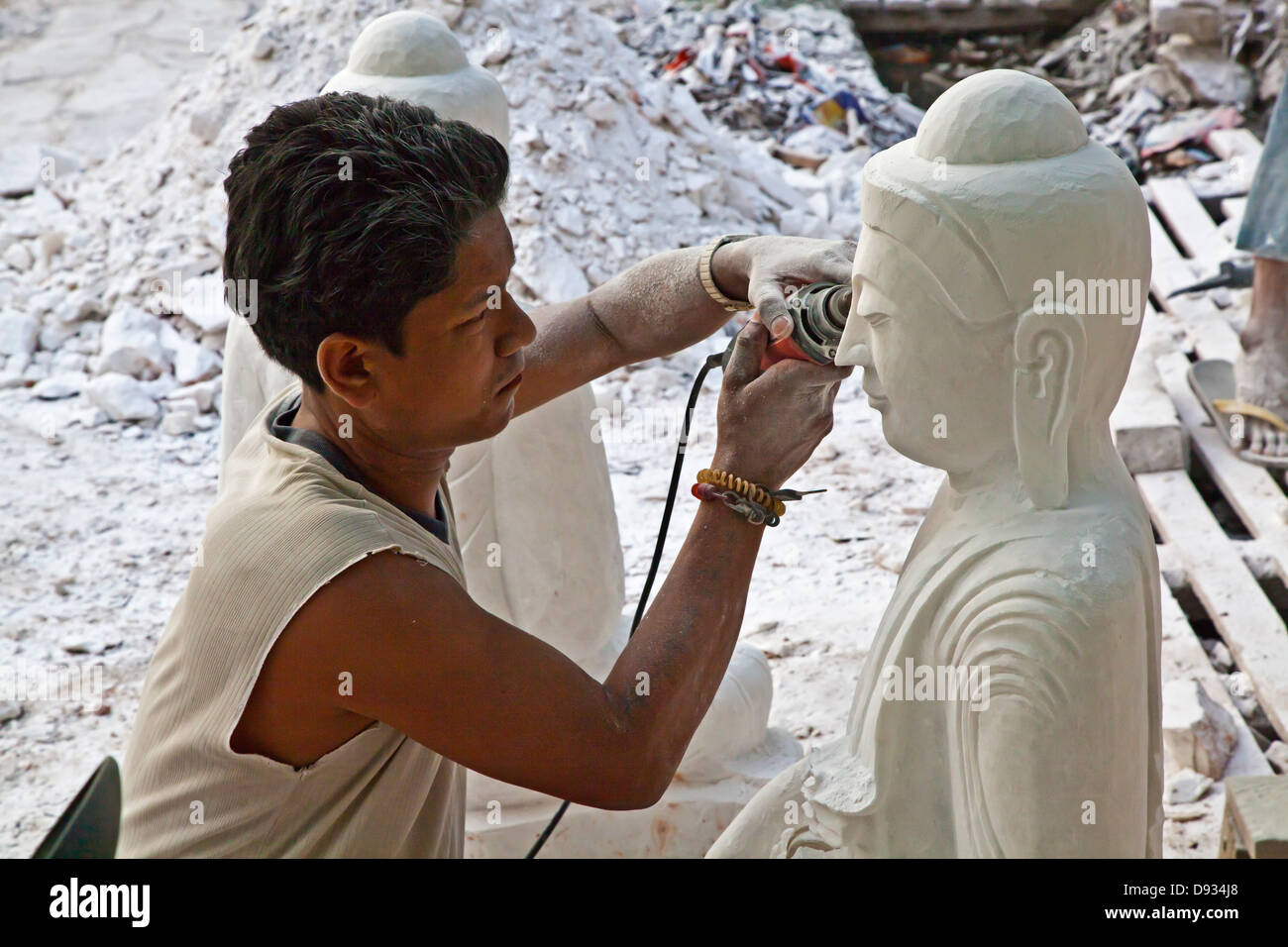 The carving of BUDDHA images is a living art in MANDALAY - MYANMAR - Stock Image