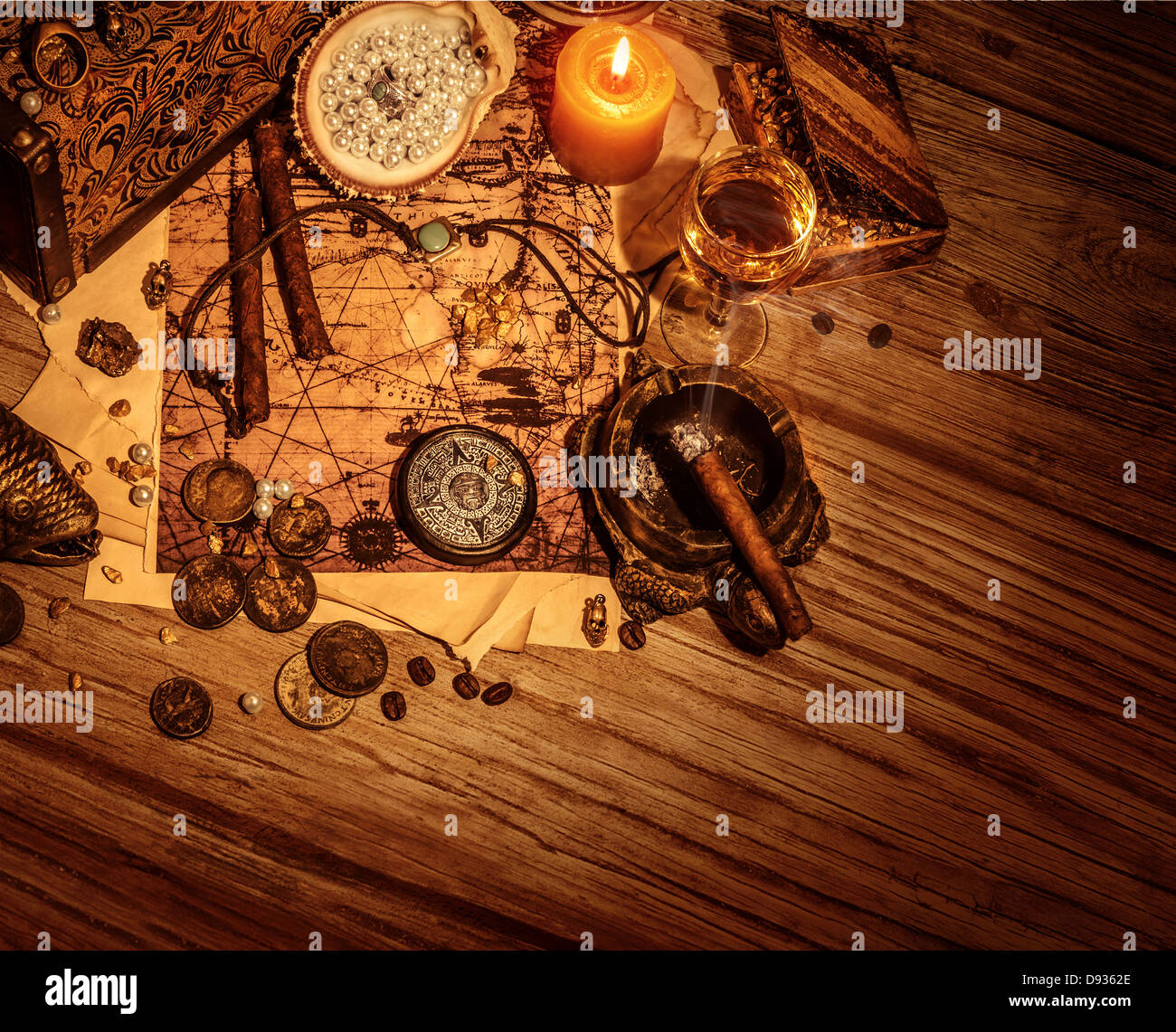 Border of pirates booty on wooden background, stolen treasure still life on the table in filibuster room - Stock Image