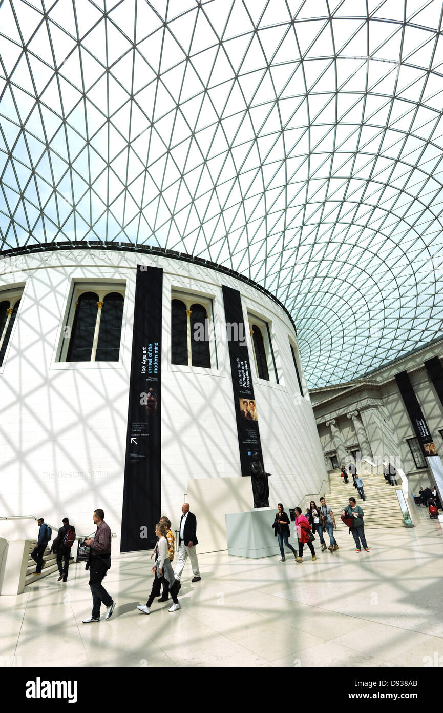 Inside the Queen Elizabeth II Great Court at the British Museum with its spectacular glass roof and Reading Room - Stock Image