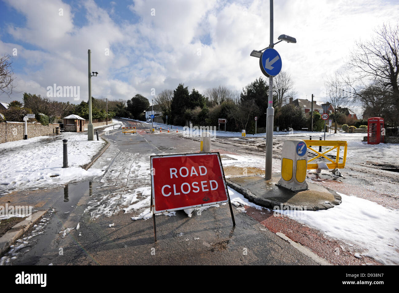 The A259 road closed at East Dean because of heavy snow - Stock Image