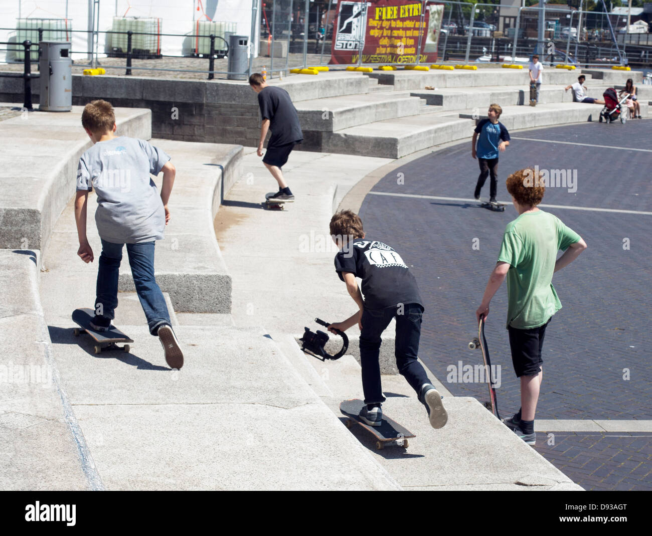 Kids skateboarding on waterfront Bristol - Stock Image