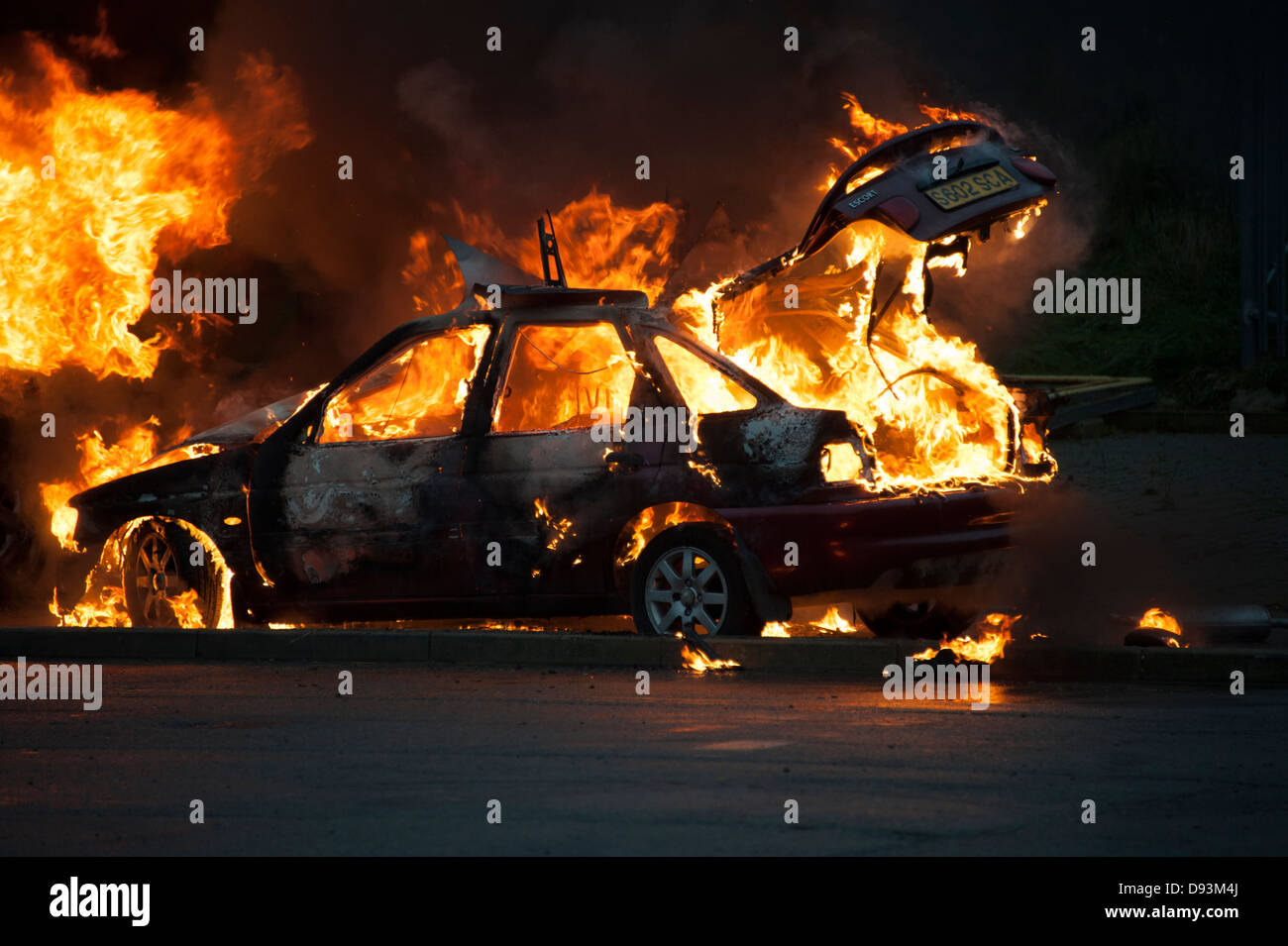 Car on Fire Blazing Flames Arson - Stock Image