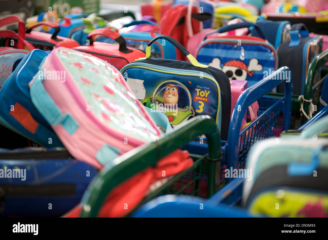 Piles of school lunch boxes in a primary school canteen - Stock Image