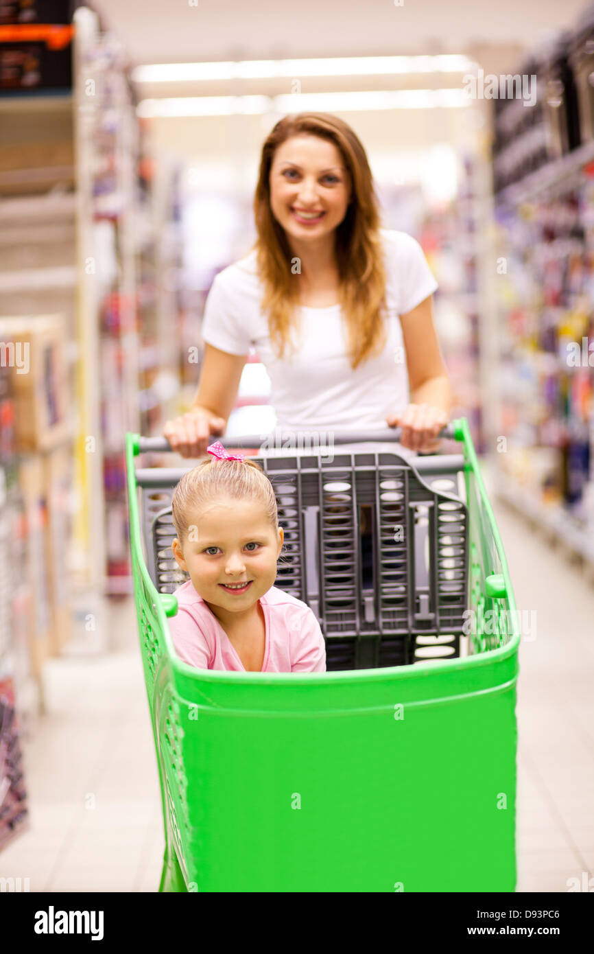 mother and daughter in shopping mall - Stock Image