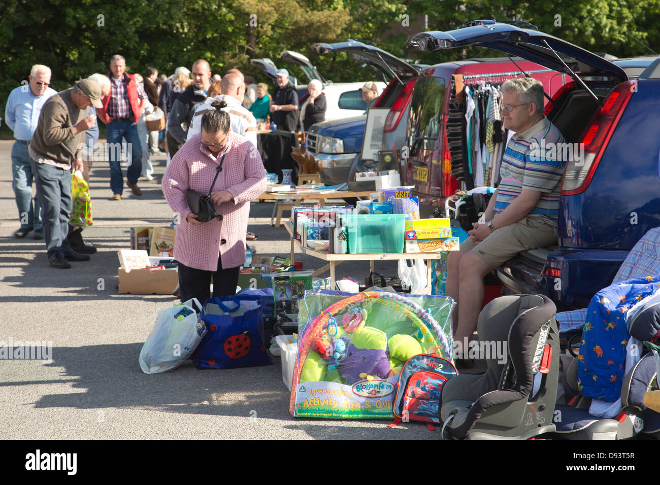 People selling items at a car boot sale in Cowbridge, South Wales, United Kingdom - Stock Image