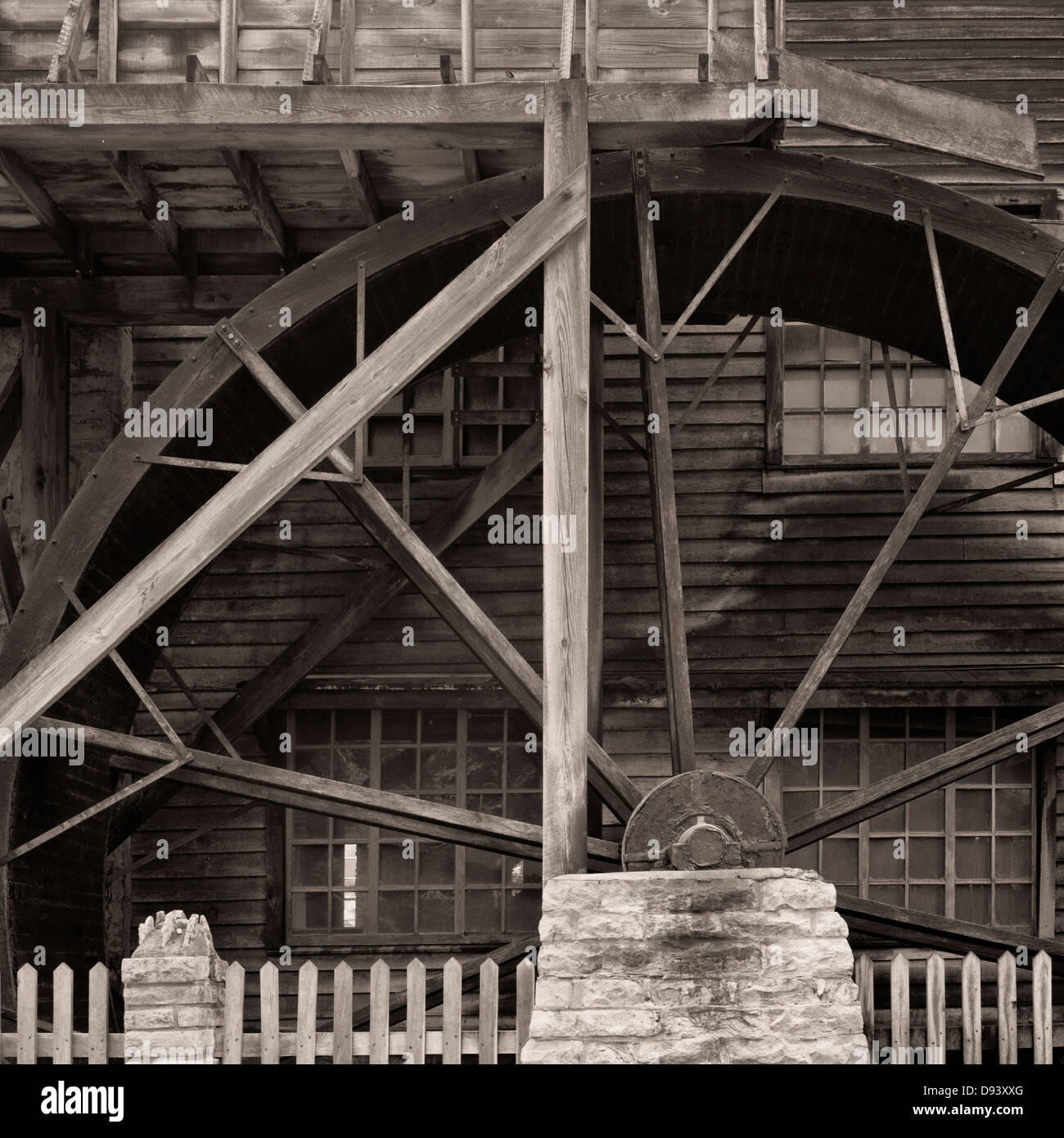 The exterior of a grist mill showing a portion of the water wheel at Pioneer Village in Spring Mill State Park, - Stock Image
