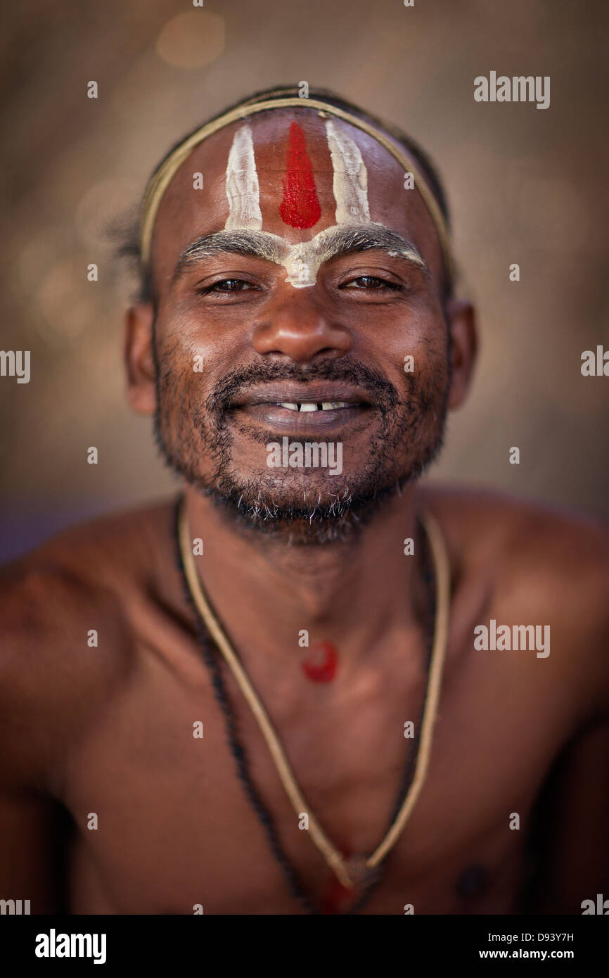 Portrait of a holy man at the Kumbh Mela 2013 in Allahabad, India - Stock Image