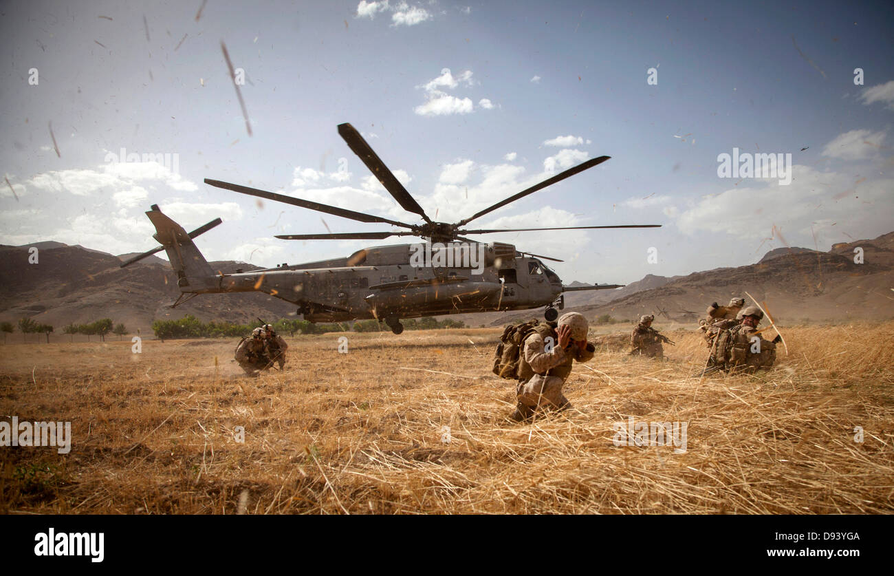 US Marines exit a CH-53E Super Stallion during a clearing operation part of Operation Nightmare June 6, 2013 in - Stock Image
