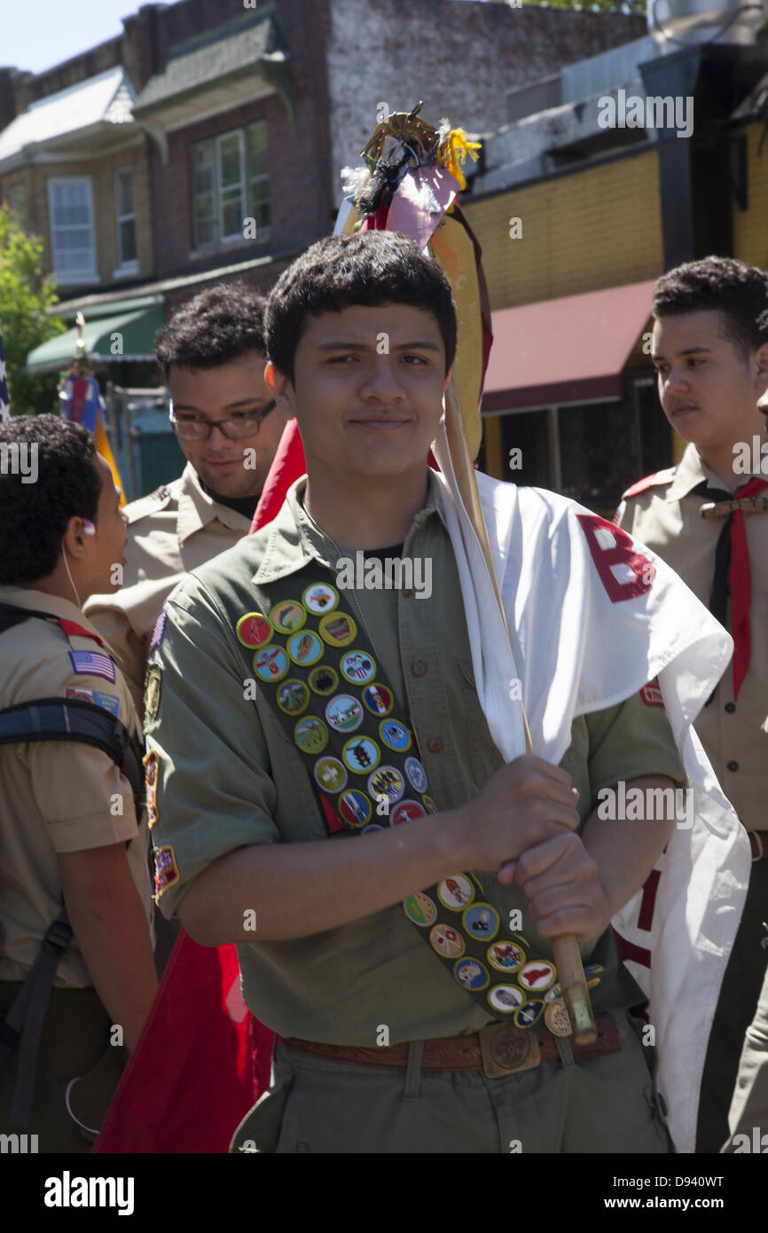 Boy Scout displays many merit badges across his chest waiting to march in the Memorial Day Parade in Bay Ridge, - Stock Image