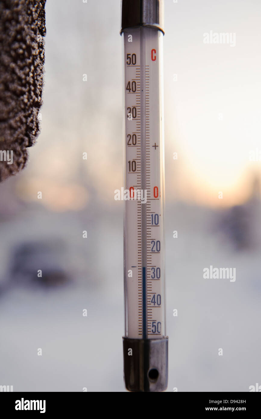 Thermometer reading minus thirty Celsius degrees - Stock Image
