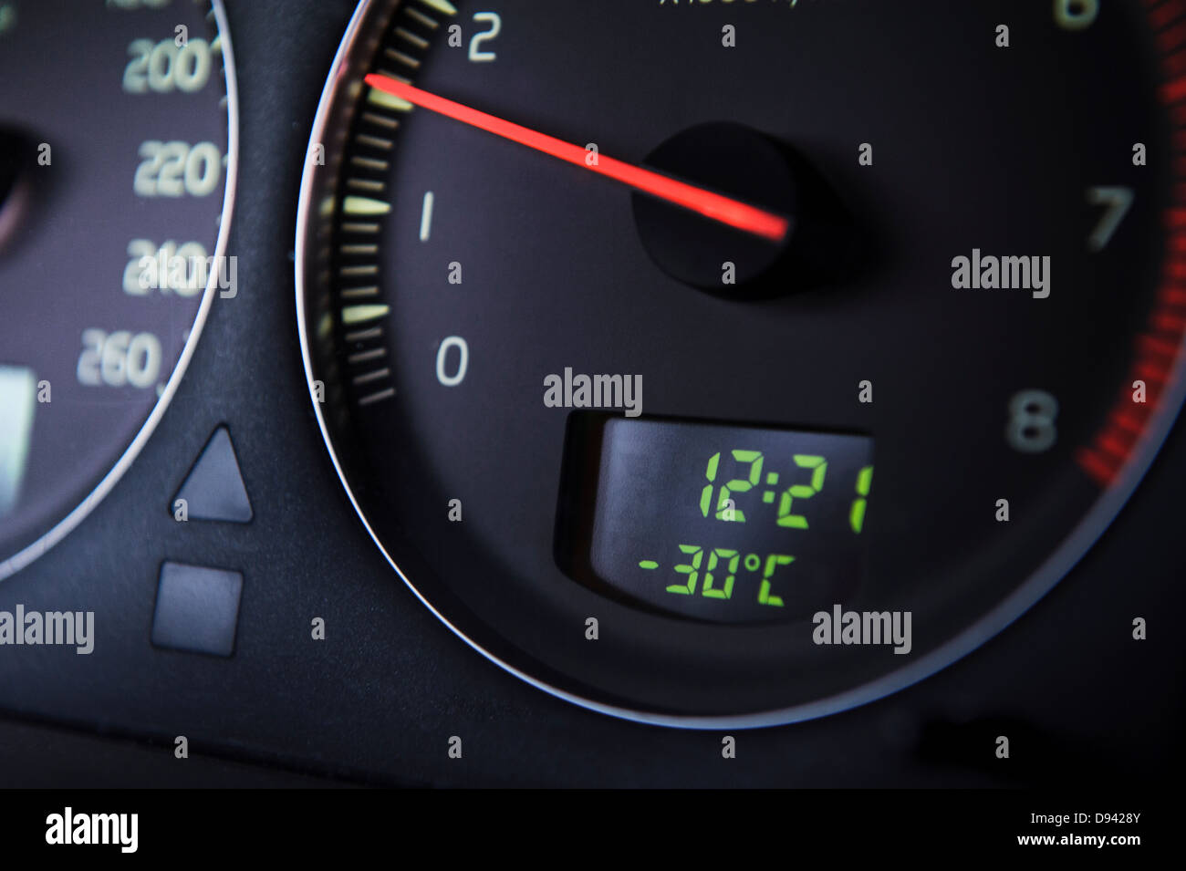 Car Odometer with thermometer reading minus thirty Celsius degrees - Stock Image