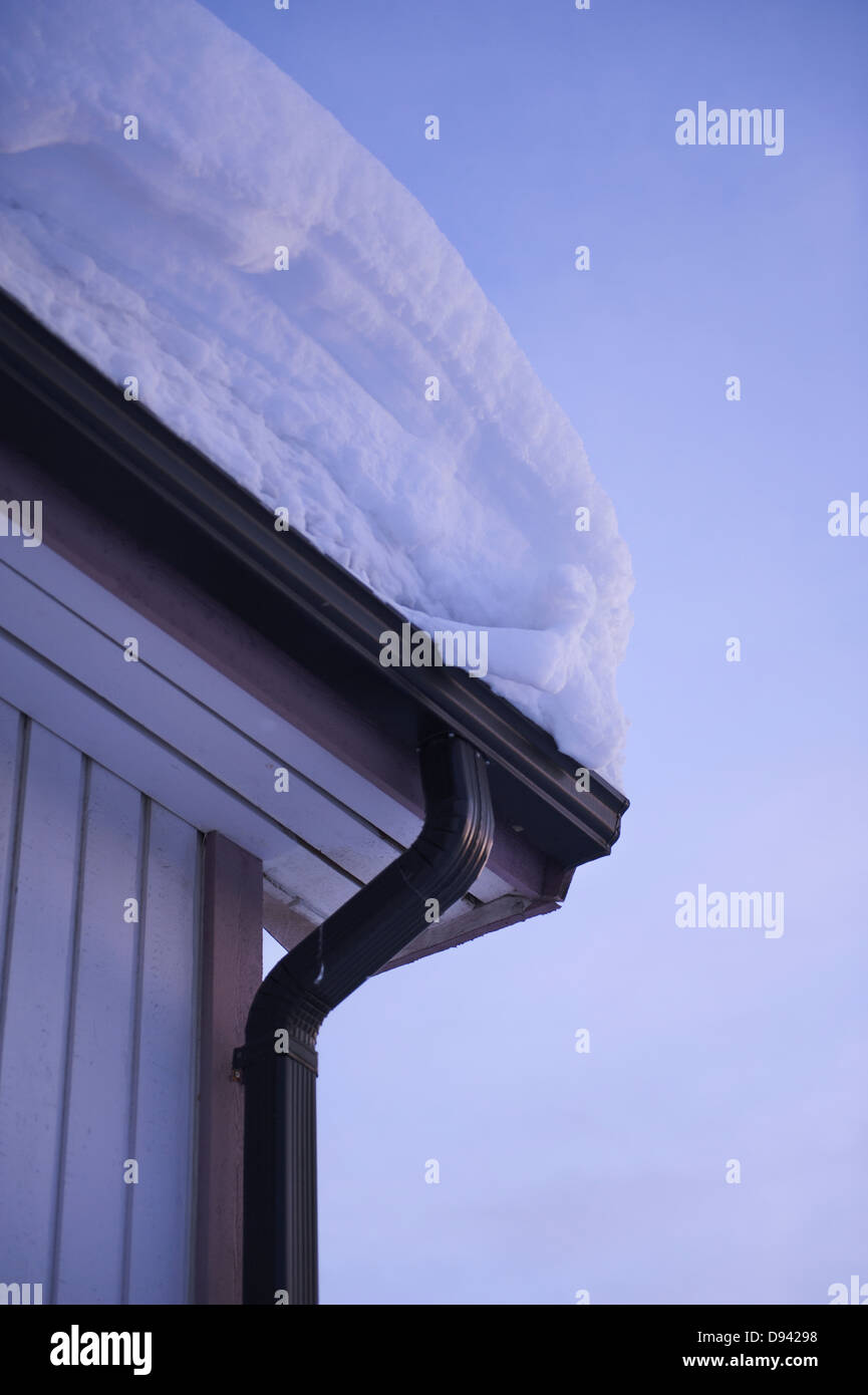 Snow covered house roof - Stock Image