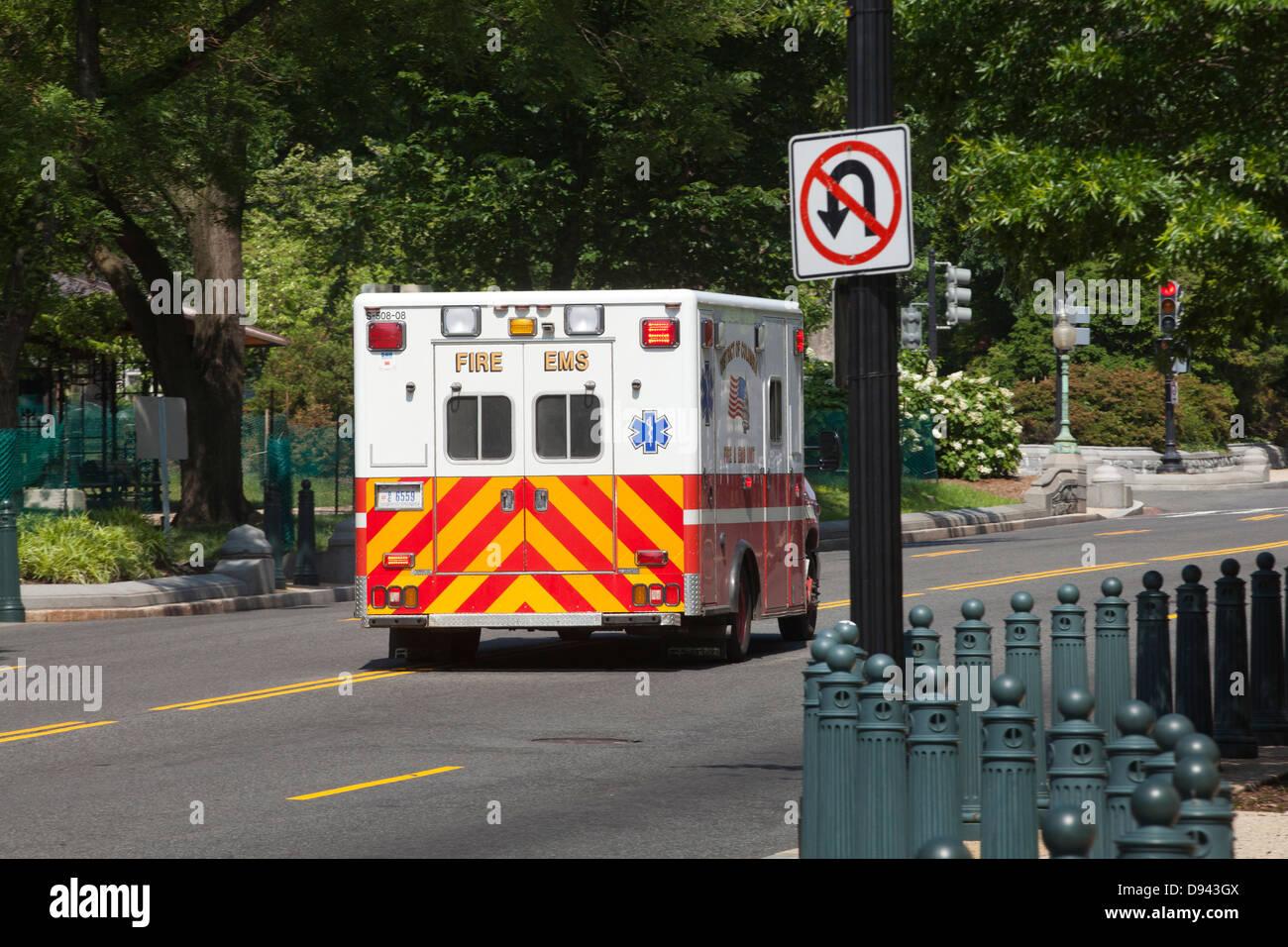 Ambulance driving away - Stock Image