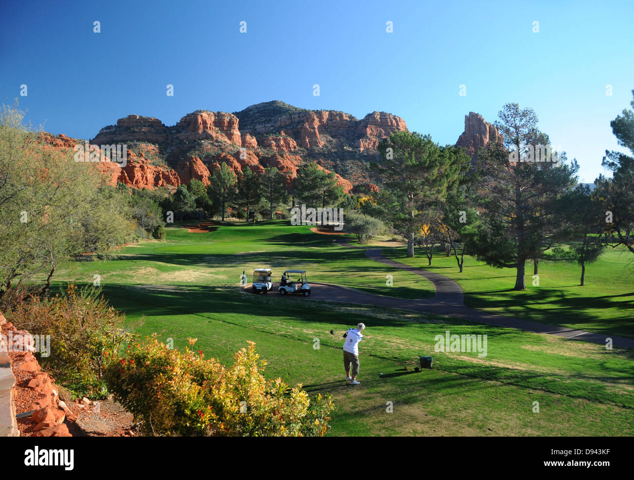 Oakcreek Country Club golf course in Sedona, Arizona surrounded by red rock formations - Stock Image