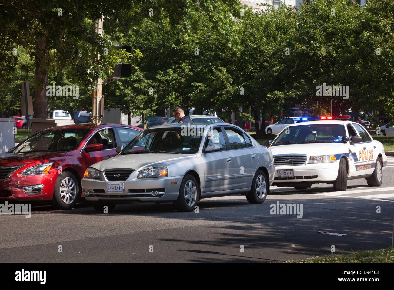 Police at minor traffic accident scene - Washington, DC USA - Stock Image
