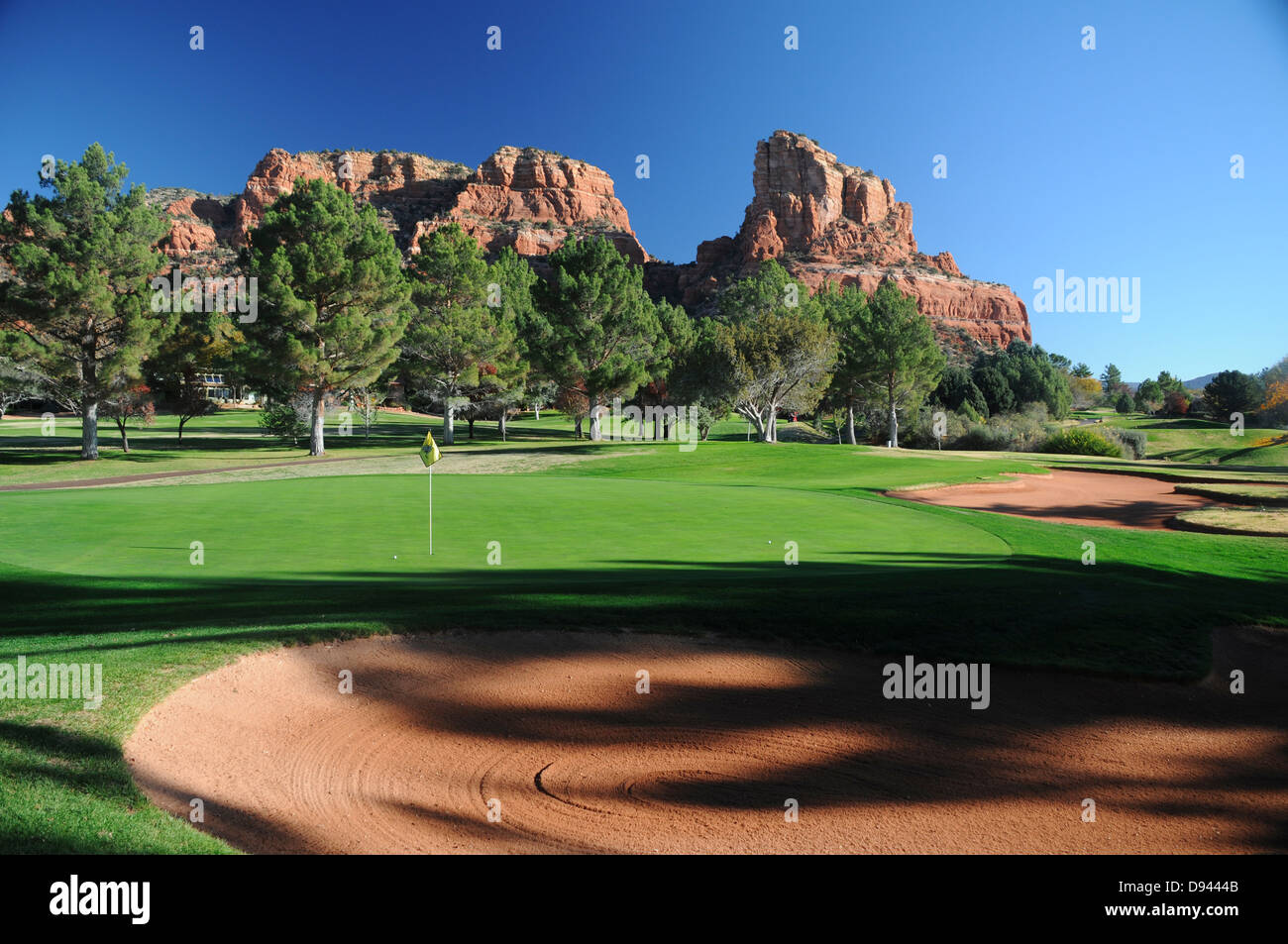 Oak Creek Country Club golf course in Sedona, Arizona surrounded by red rock formations - Stock Image