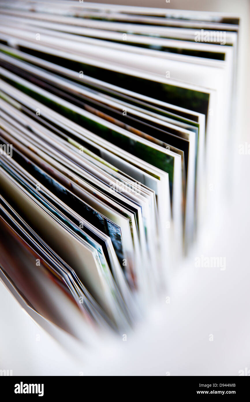 Open book with several pictures - single sheets and groups of pages visible - Stock Image