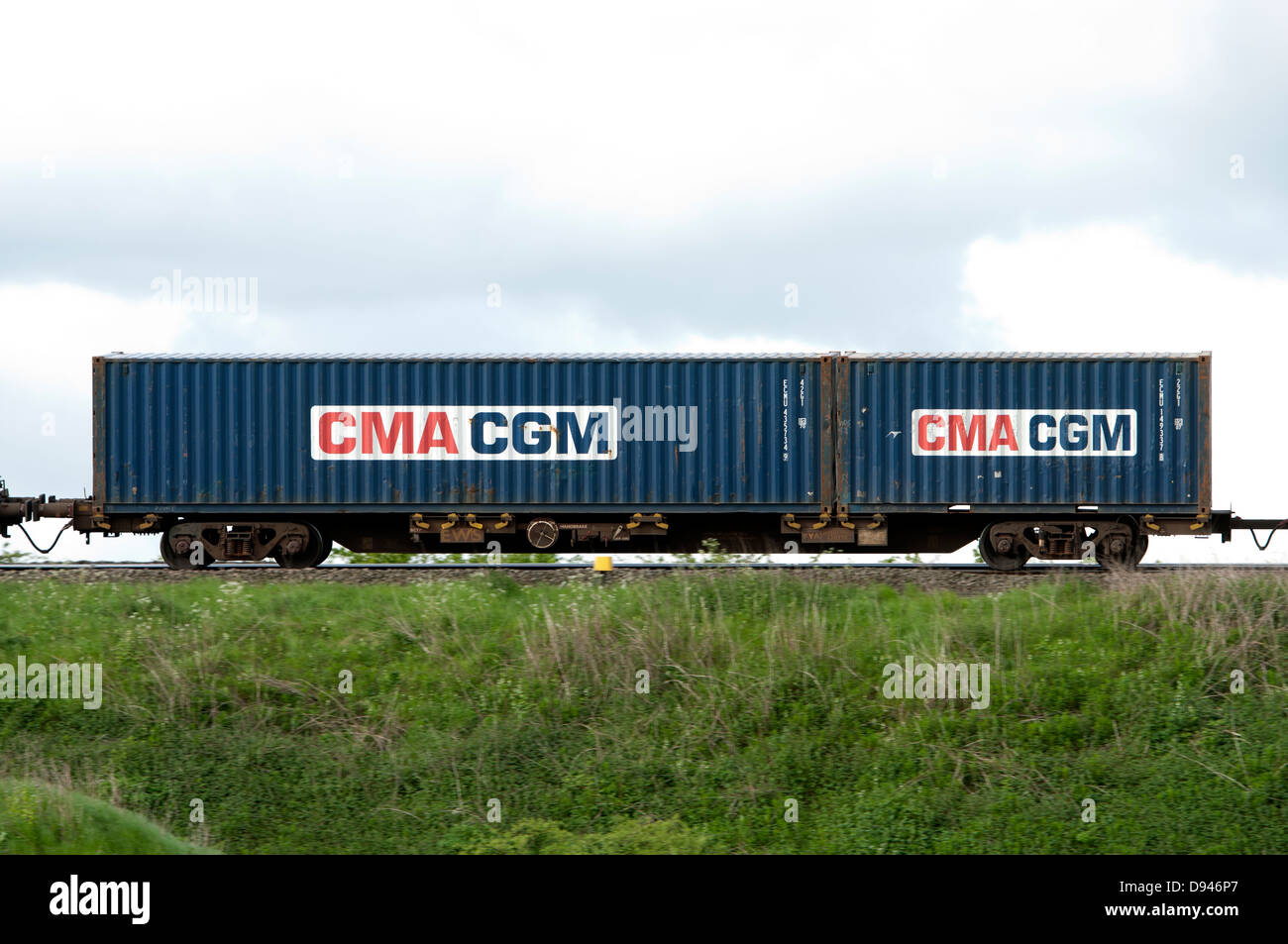 CMA CGM shipping container on train - Stock Image