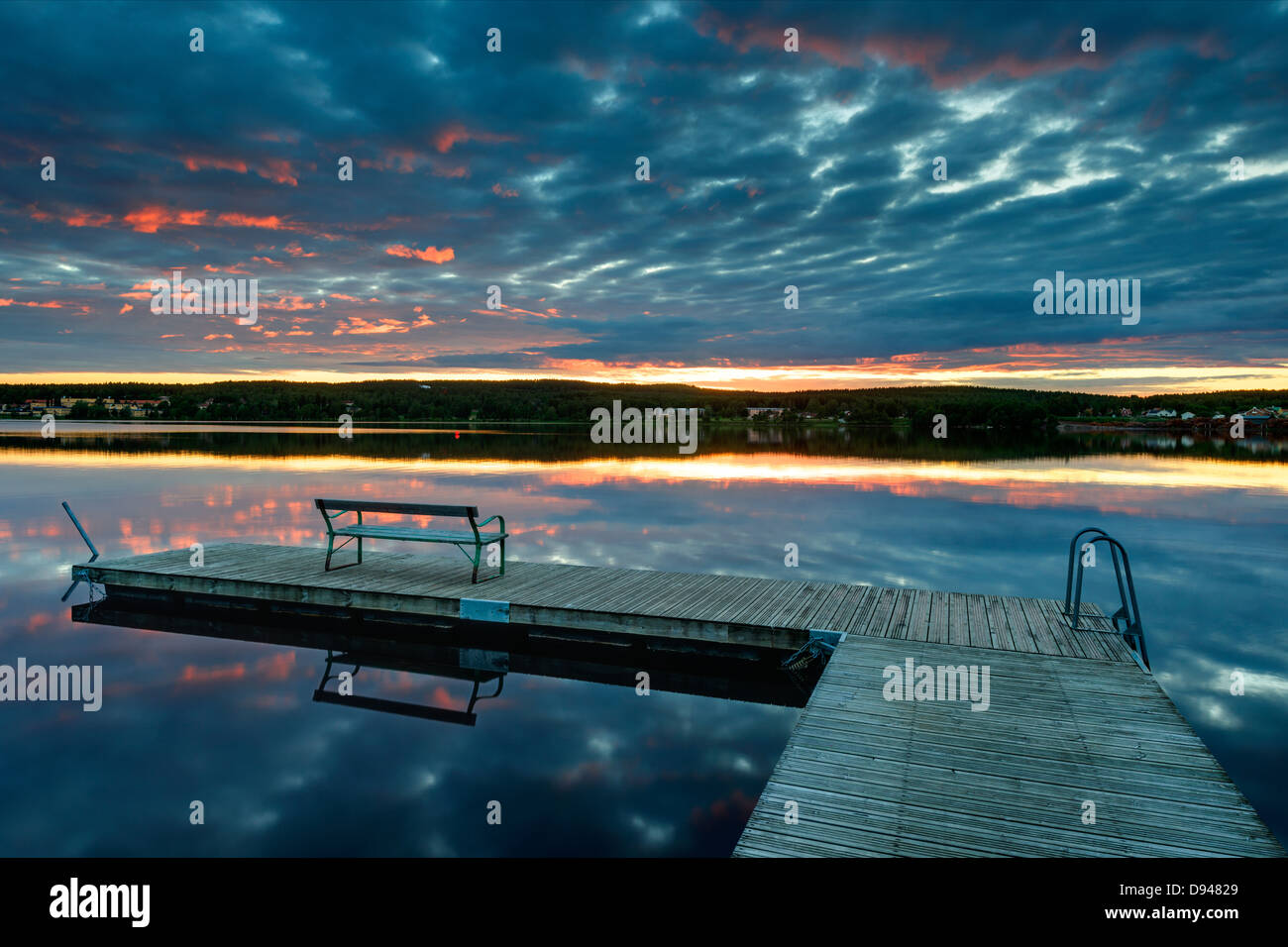 Empty jetty at sunset - Stock Image