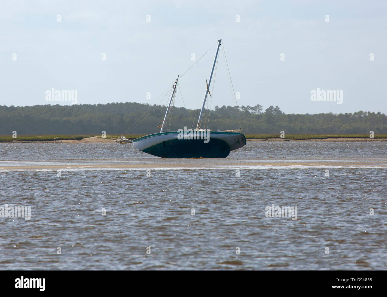 Two masted schooner run aground on a sand bar in the Intracoastal Waterway in Georgia - Stock Image