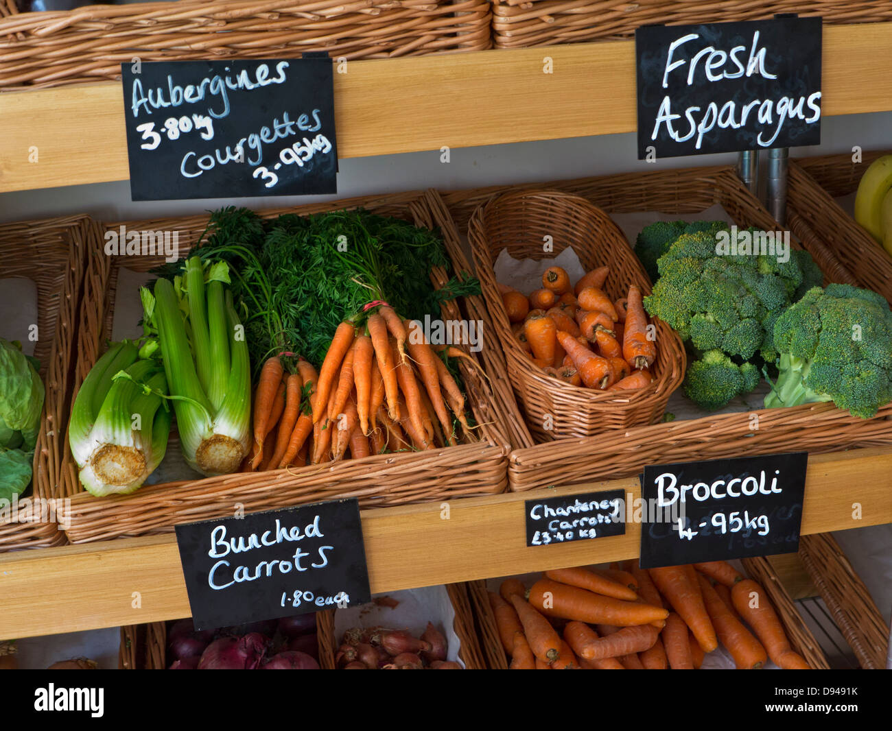Traditional high street produce farm shop interior with fresh local fruit and vegetables on sale Stow on the Wold - Stock Image