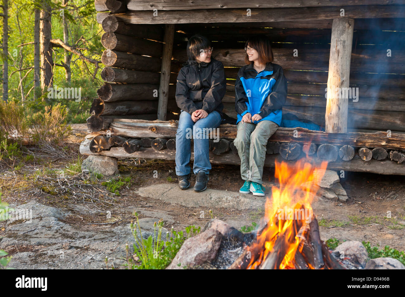 Two female tourists camping - Stock Image