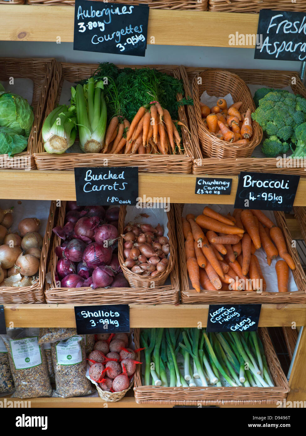 Traditional high street produce farm shop interior with fresh local fruit and vegetables on sale in Kilos blackboards - Stock Image
