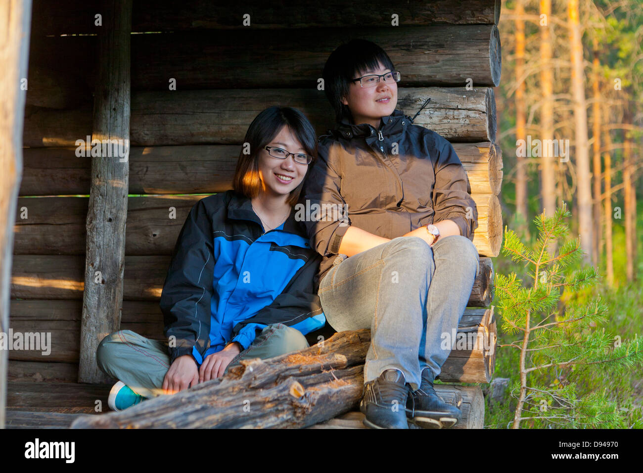Two female tourists in shelter - Stock Image