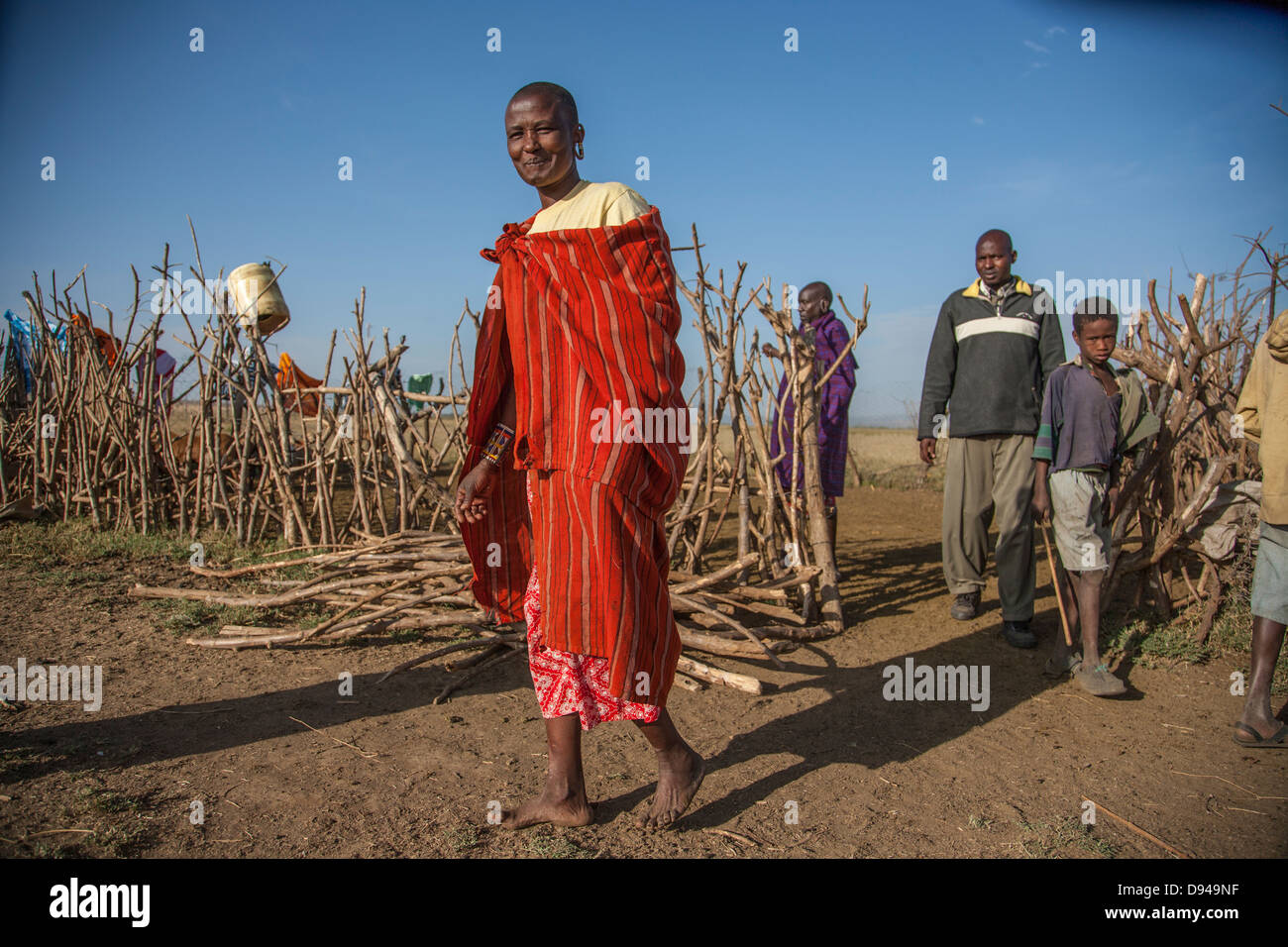 Maasai family in Rift Valley of Africa herding goats Stock Photo